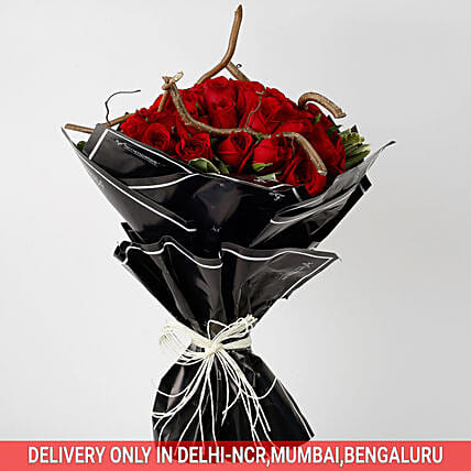red roses celebration bouquet in black paper