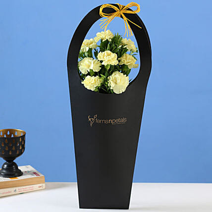 Yellow Carnations in Black FNP Sleeve Bag:Yellow Flowers