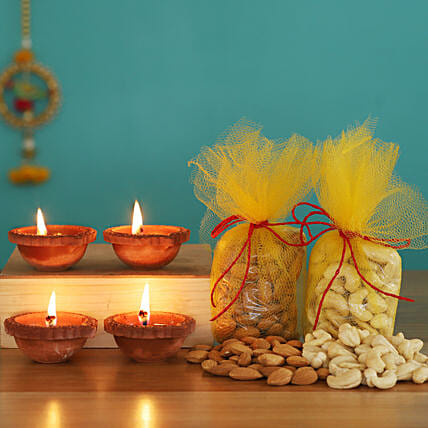 Almond & Cashew Potlis With 4 Clay Diyas