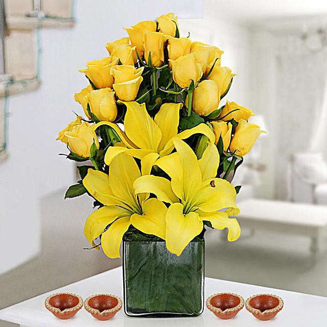Yellow Flower Arrangement with Diya Online