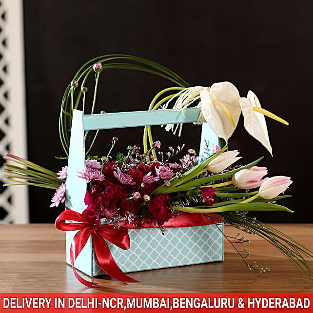 mix of anthurium and carnation hand box arrangement online
