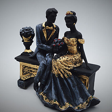 Antique Couple Showpiece Sitting On A Bench
