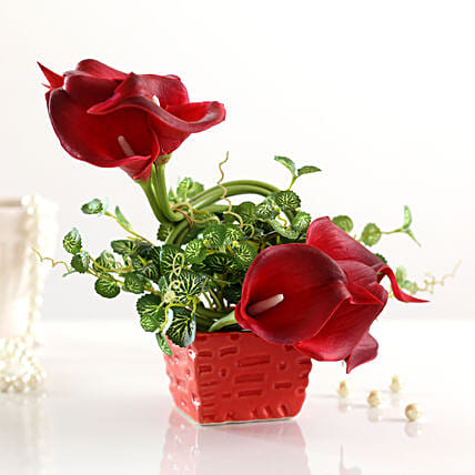 faux red calla lilies in red pot arrangement online
