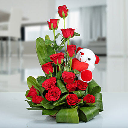 Beauty of Nature Basket - 15 red roses are arranged in a basket arrangement with a .