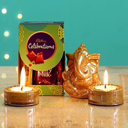 Beige Ganesha Idol & Candles With Cadbury