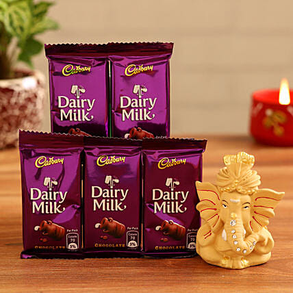 Online  Ganesha Idol and Dairy Milk