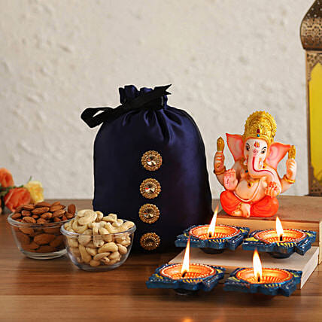 Online Blessed Ganesha Idol With Diyas & Dry Fruits Potli