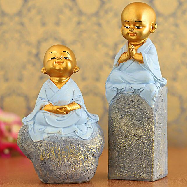 Blue Praying Monk Idols On Rock