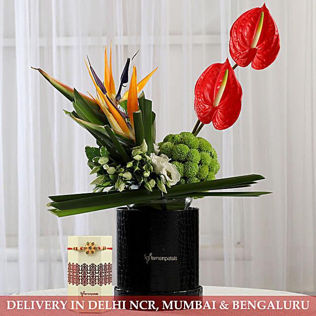 Designer Flower Arrangement and Rakhi