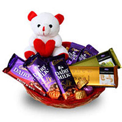 Branded Chocolate Basket-Hamper includes: Basket of 5 Dairymilk silk chocolates 65 grams each with 2 temptations 72 grams each,100gm Home made chocolates and 6 Inch teddy bear:Soft toys to Dehradun