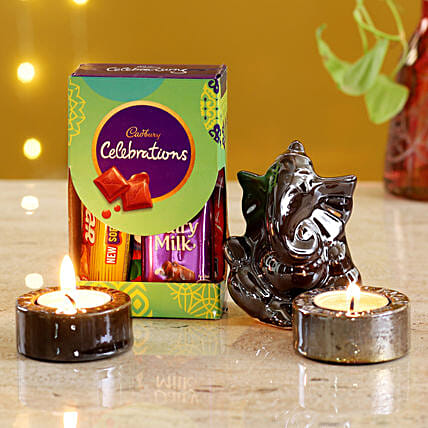 Brown Ganesha Idol & Candles With Cadbury:Buy Cadbury Chocolates