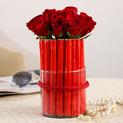 online roses in cylindrical vase