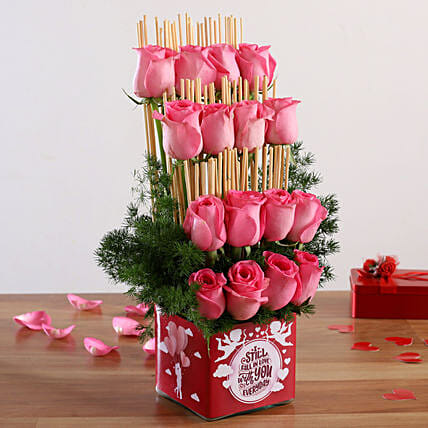 pink roses in  vase arrangement for valentine