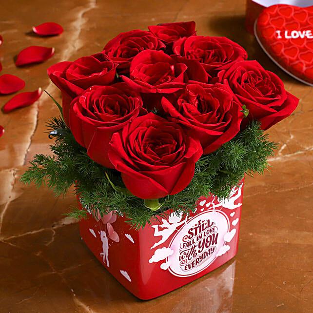 red roses in printed vase arrangement for valentine