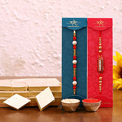 Buy capsule and pearl rakhi set with kaju katli