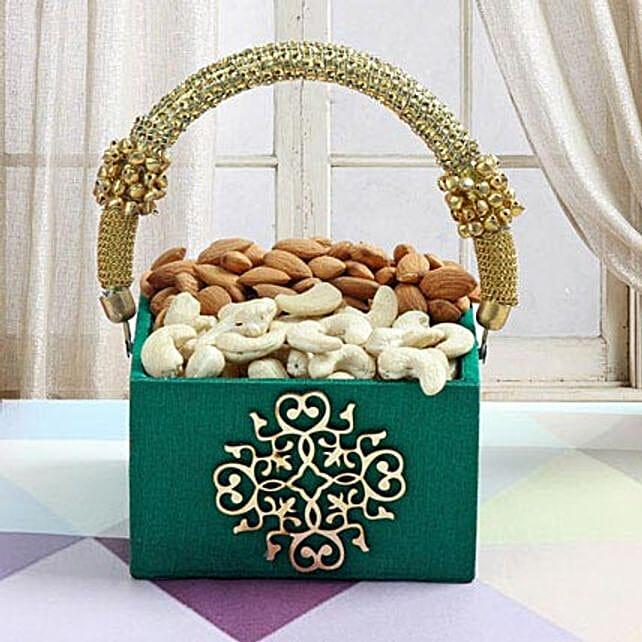 Dry fruits in a designer green cane basket