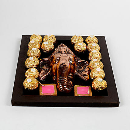 ganesha idol with sweet treat