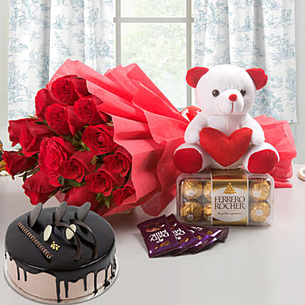 Complete Love Hamper - Bunch of 15 Red Roses with Soft toy, Ferrero Rocher, 5 Cadbury Chocolates and 500gm Chocolate Cake.