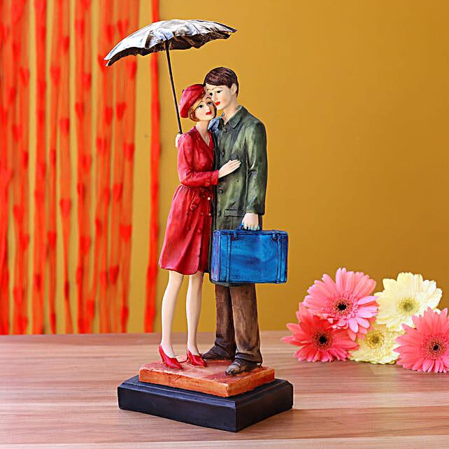 Couple Under Umbrella With Suitcase Figurine