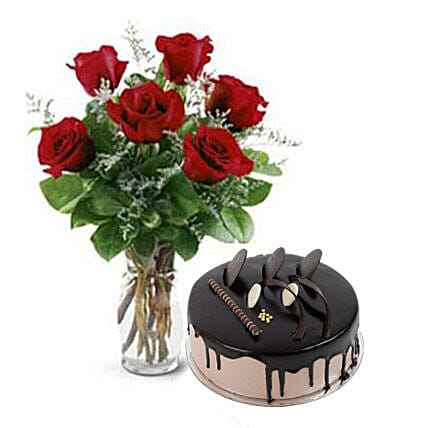 Cute Love - 6 red roses in a glass vase with 500gm chocolate cake.