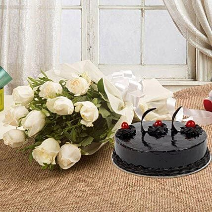 Delicious & Elegant Treat - Bunch of 10 white roses in paper packing and 500 grams of chocolate truffle cake.:Gifts for Cancerians