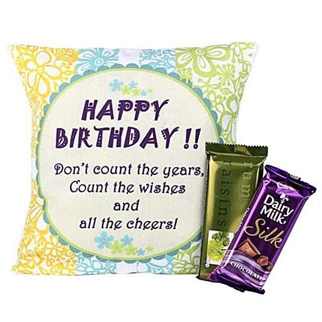 Delightful Birthday-12X12 inches Cushion with message Happy Birthday,1 Dairy Milk Silk 65grams,1 Rum Raisins Temptations of 72 grams