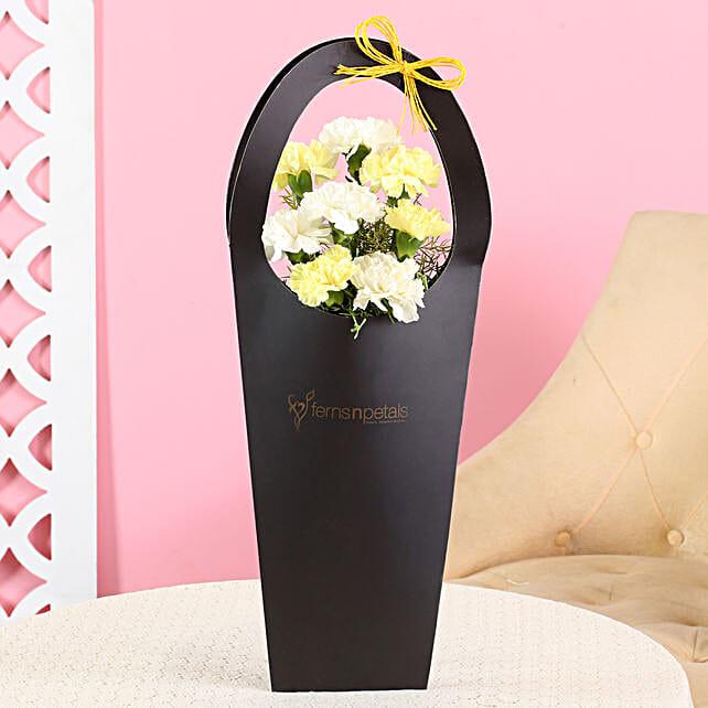 carnation arrangement in black sleeve bag