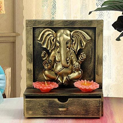Ganesha with candles