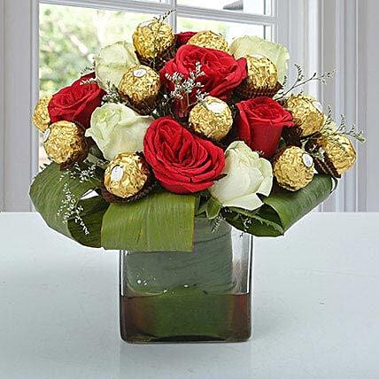 Glass vase arrangement of roses and ferrero rochers:Bhai Dooj Gifts Chandigarh