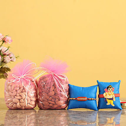 Order Capsule and Bal Ganesha Rakhi With Dry Fruits Online