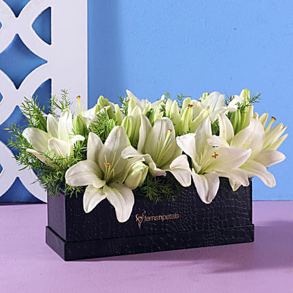white flower in rectangle black box online:Flowers for Janmashtami