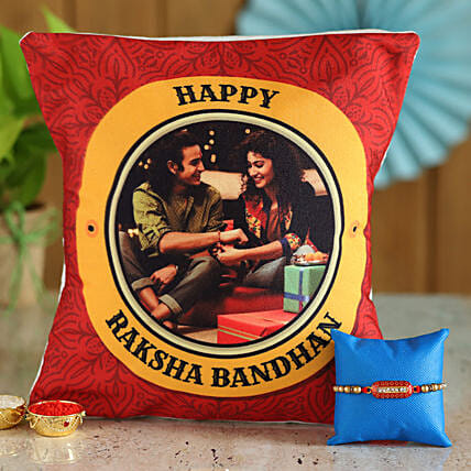 Pearl rakhi with printed cushion for brother