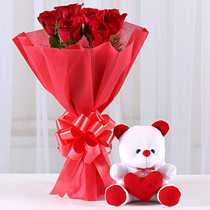 Flowerly and Fluffily Yours - Gift hamper of 6 Red Roses along with 1 small . gifts:Flower N Teddy