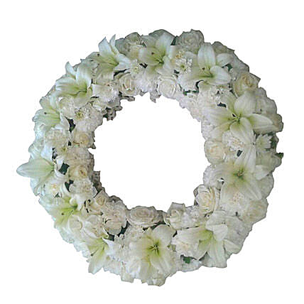 A fresh flower wreath with white roses, white carnations and white asiatic lilies:Flower Delivery in Dindigul