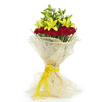 Fresh start - Bunch of 12 Red Carnations with 5 Yellow Asiatic lilies in a jute packing with raffia knot.