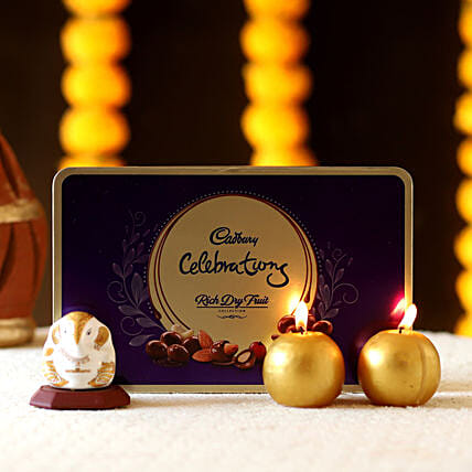 diwali chocolates with idol and candle for home