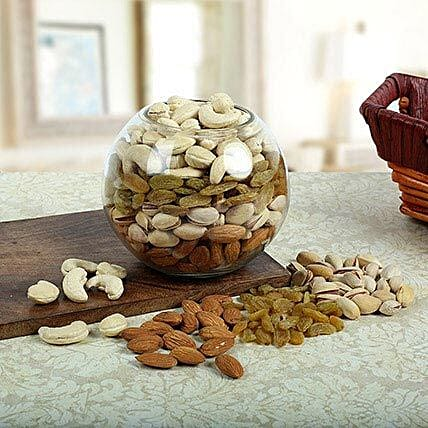 Dry fruits in a glass vase:Send Gourmet Gifts