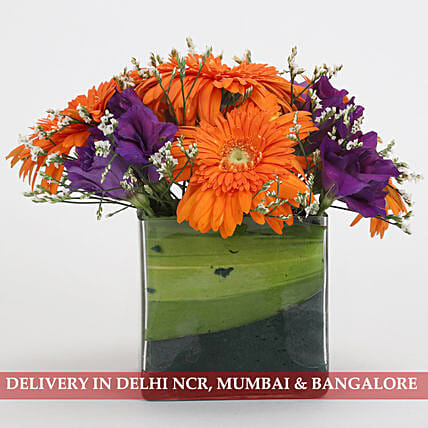 exotic floral arrangement in square vase