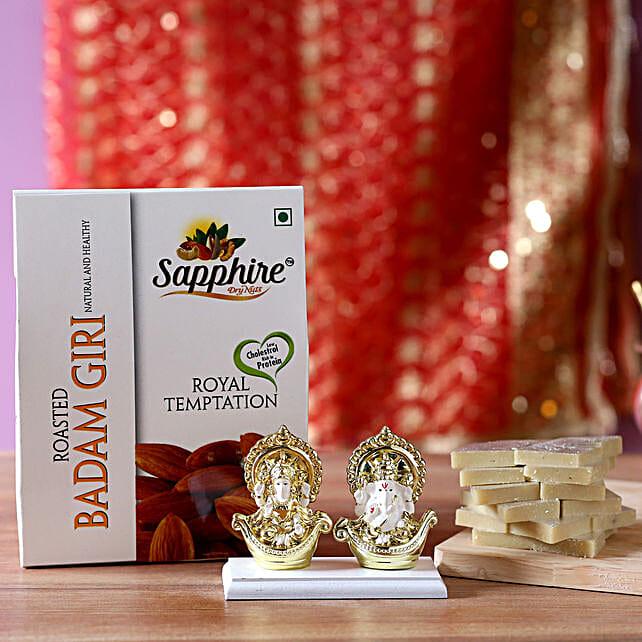 laxmi n ganesh idol with sweet n dryfruits