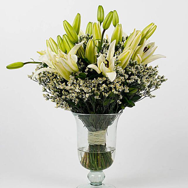 exclusive white lilies in unique shape vase