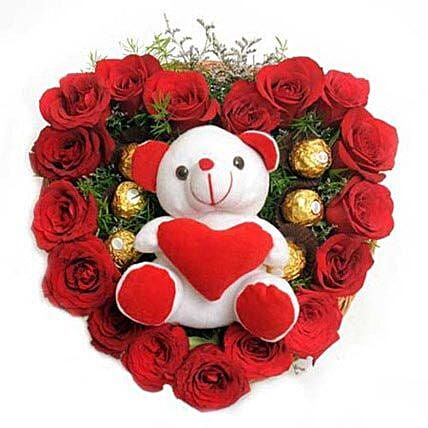 Love Combo - Heart shape arrangement of 17 Red Roses, 16 Pieces ferrero rocher & Soft toy with green fillers.