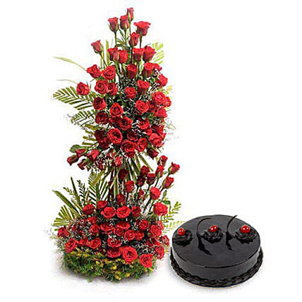 Love Never End - Life size arrangement of 100 Red roses with mix seasonal fillers with 1kg Chocolate truffle Cake.