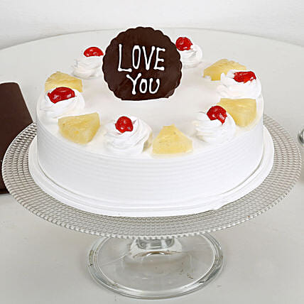 Fresh Pineapple cake with love u topper:Cakes to Shivpuri