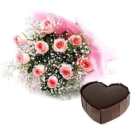Lovely Blooms - Bouquet of 10 pink roses with lots of fillers in a paper packing finished with a ribbon and 1 kg of heart shaped  cake.:Heart Shaped Gifts