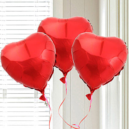 Red heart shaped balloons:Send Romantic Valentine Gifts