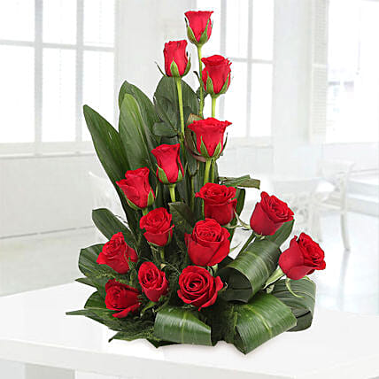 Cane basket arrangement of 15 red roses, draceane leaves and seasonal filler flowers gifts:Father's Day Flower Bouquet