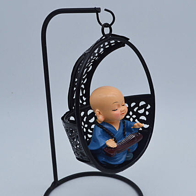 Meditating Monk On A Swing