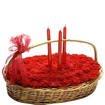 Perfect Surprise - Basket Arrangement of 40 Red Carnations with 3 Candles.