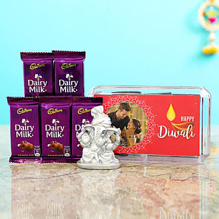 Pink Diwali Box With Silver Ganesha Idol & Dairy Milk