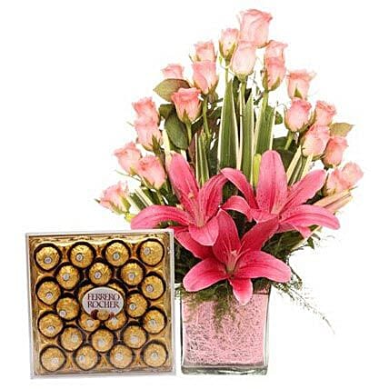 Pink Sweetness Reflected - Glass vase arrangement of 20 pink roses with 2 pink asiatic lilies and Ferrero Rocher chocolates.:Premium Flowers